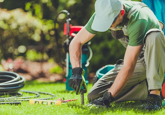 Irrigation specialist installing a sprinkler head
